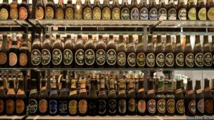 Carlsberg beer bottles are pictured in a beer museum at the Carlsberg headquarters in Copenhagen