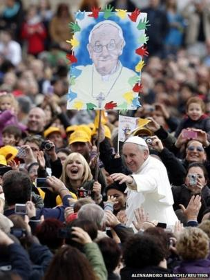 Pope Francis arrives to conduct his weekly general audience at St Peter's Square at the Vatican