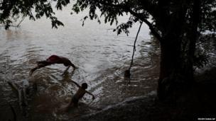 Xavante Indians jump into the Cuiaba river