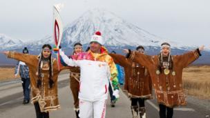 Russian torchbearer carries the Sochi 2014 torch