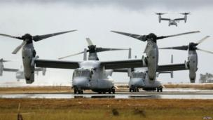 Four Ospreys from the US Navy Ship (USNS) Charles Drew prepare to taxi on the tarmac of Tacloban airport in the aftermath of super typhoon Haiyan, 14 November 2013