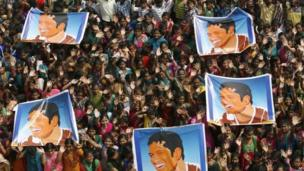 Indian school children display posters of the Indian cricket star Sachin Tendulkar as they gather to honour him in Chennai on 14 November