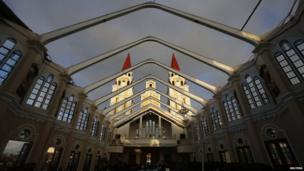 The twin towers of the Metropolitan Cathedral of the Archdiocese of Palo are seen through a devastated roof on 15 November 2013