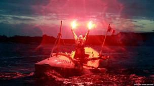 Solo woman rower Mylene Paquette of Canada celebrates as she arrives at Lorient harbour