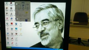 A computer screen with an image of Mir Hossein Mousavi