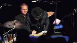 Van Morrison signs scroll
