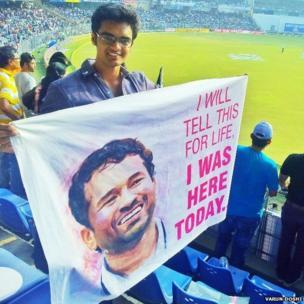Varun Doshi holding a banner