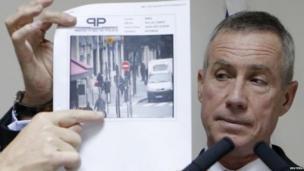 Paris prosecutor Francois Molins with image, 18 Nov
