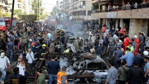 Lebanese people gather at the scene where two explosions struck near the Iranian embassy in Beirut, Lebanon, 19 Nov