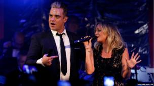 Robbie Williams and Emma Bunton perform a duet