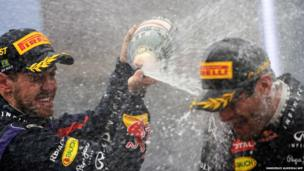German driver Sebastian Vettel of Red Bull (left) celebrates his victory on the podium with his fellow driver Australian Mark Weber in the Brazilian Formula one Grand Prix at the Interlagos racetrack in Sao Paulo, Brazil
