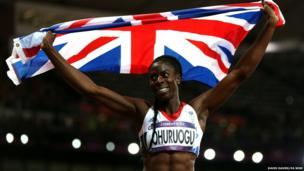 Christine Ohuruogu holding up a union flag