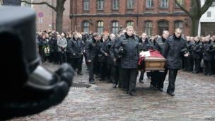 Funeral of a firefighter killed in Latvia's supermarket collapse, on 27 November 2013