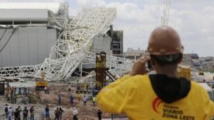 A worker surveys the damage at Arena Corinthians