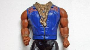 Mr T action figure missing its head.