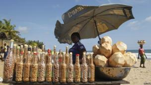 Bottles of peanuts and coconuts for sale on a beach near Abidjan, Ivory Coast - Saturday 23 November 2013