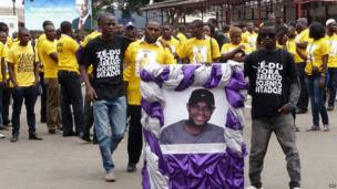 Opposition activists in Angola gather for the funeral procession for Hilbert Ganga in Luanda, Angola - Wednesday 27 November 2013
