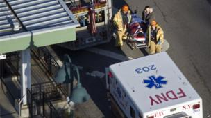 A person is evacuated from the scene of the derailment of a Metro-North passenger train in the Bronx borough of New York