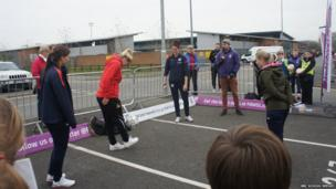 Doncaster striker Millie Bright showing off her ball-juggling skills watched by England and Birmingham left-back Rachel Unitt (left) and England and Manchester City midfielder Jill Scott (centre)