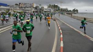 Competitors take part in a marathon in Libreville, Gabon - Sunday 1 December 2013