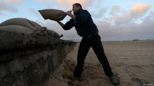 Man lifting sandbags