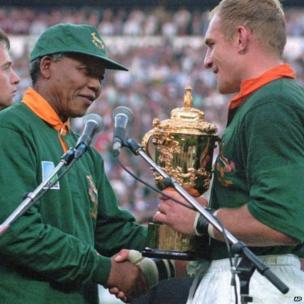 24 June 1995: South African rugby captain Francios Pienaar receives the Rugby World Cup from South African President Nelson Mandela