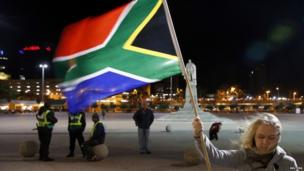 A girl holds a South African national flag outside the Cape Town City Hall. Photo: 6 December 2013
