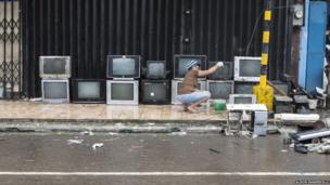 Drying out televisions in the street