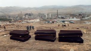 Coffins are lined in the devastated town of Spitak, on December 12, 1988, after an earthquake hit Armenia, on December 7, 1988.