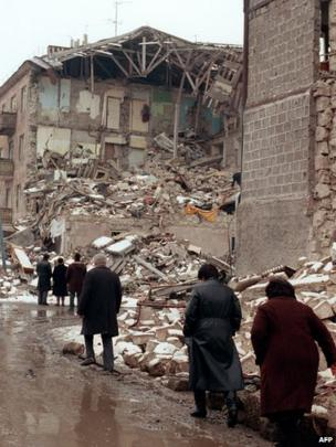 Survivors walk in the devastated town of Leninakan, on December 15, 1988, after an earthquake hit Armenia, on December 7, 1988.
