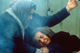 Survivors comfort each other after an earthquake hit Armenia, on December 7, 1988.