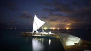 A sailing canoe sits in dock ahead of the Queen's Baton's next adventure in Tarawa, Kiribati.