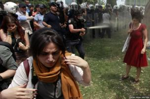 Turkish riot police blast a woman with pepper spray as anti-government protestors take part in a demonstration at Taksim Square, Istanbul, 28 May 2013