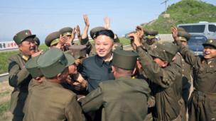 This picture taken by North Korea's official Korean Central News Agency on 2 June 2013 and released on June 4 shows North Korean leader Kim Jong-un (C) being greeted by soldiers as he inspects watch posts defending Mt Osong and Korean People's Army (KPA) unit 507 in the Kangwon province of North Korea