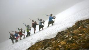 Midsummer's Day skiers from team Tiso set off from Aonach mor on the Nevis Mountain range as thick fog covers the hills of Fort William