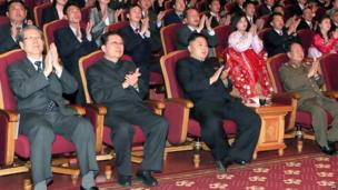 KCNA image released on 15 April 2013 shows Kim Jong-un (C-front) applauding at the Unhasu orchestra concert at the People's Theatre in Pyongyang to celebrate the 101st anniversary of the birth of late leader Kim Il-sung, as his uncle, Chang Song-thaek (front 2nd L), looks on