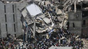 People rescue garment workers trapped under rubble at the Rana Plaza building after it collapsed, in Savar, 30km (19 miles) outside Dhaka, 24 April 2013
