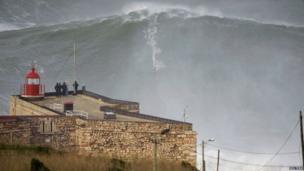 Garrett McNamara rides huge wave
