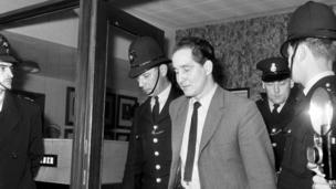 Biggs, leaving Aylesbury Courts of Assize in April 1964, after being sentenced to 30 years in prison