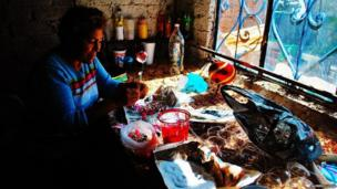 Woman making christmas decorations