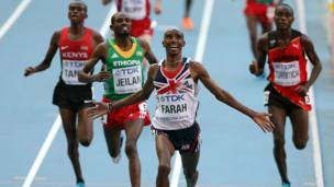 Mo Farah crossing finish line at World Athletics Championships in Moscow.