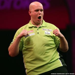 Michael Van Gerwen of The Netherlands celebrates winning a darts match
