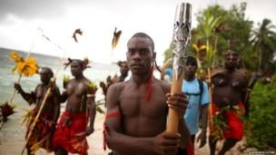 The Queen's baton is carried to a traditional ceremony in Kavieng, Papua New Guinea.