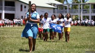 A local school girl runs with the Queen's Baton at Nauti Primary School in Funafuti, Tuvalu.