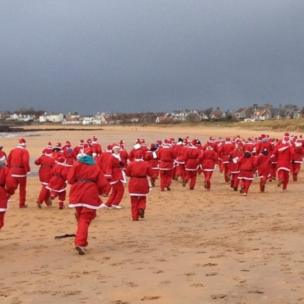 Santas taking part in the East Neuk Bolt at Elie.
