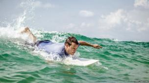 Will Tillet catches a wave off Bureh Beach
