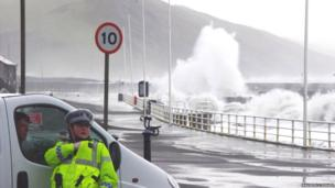 Police officer chats with van driver at seafront