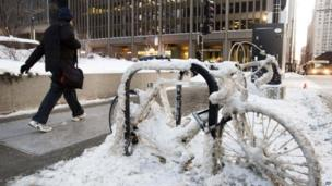 A snow encrusted bicycle in downtown Chicago