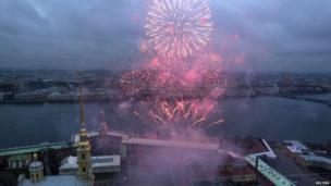 Fireworks explode over St. Peter and St. Paul Cathedral and the Neva River during festivities marking Orthodox Christmas in St.Petersburg, Russia, Tuesday, Jan. 7, 2014