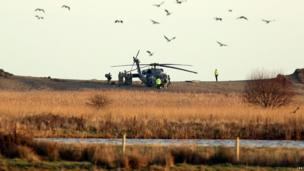 A US military helicopter near the scene at Salthouse in Norfolk following the crash of a US Air Force HH-60G Pave Hawk helicopter during a training exercise